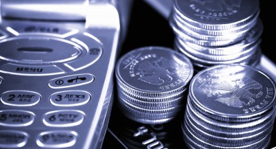 silver coins next to mobile phone buttons