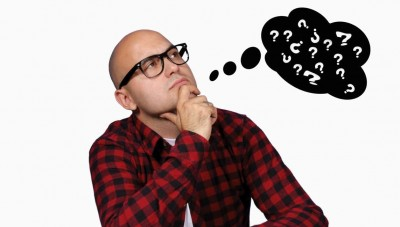 pondering man with thought bubble of question marks
