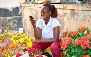 woman in market in Nairobi selling flowers