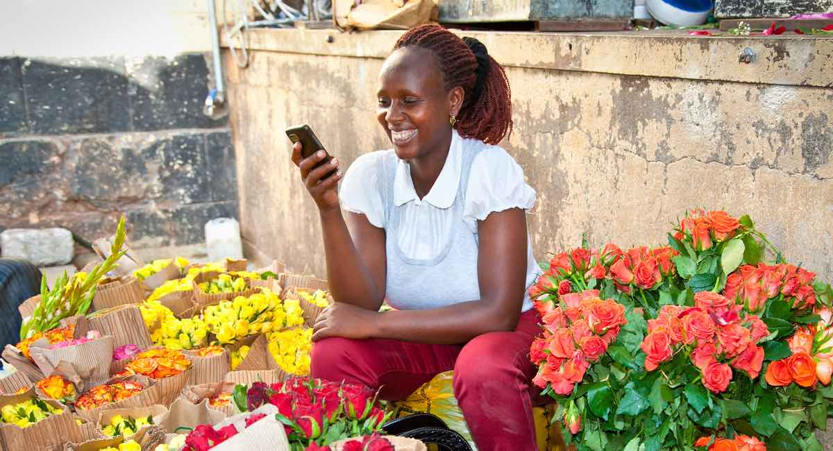 woman in market in Nairobi selling flowers