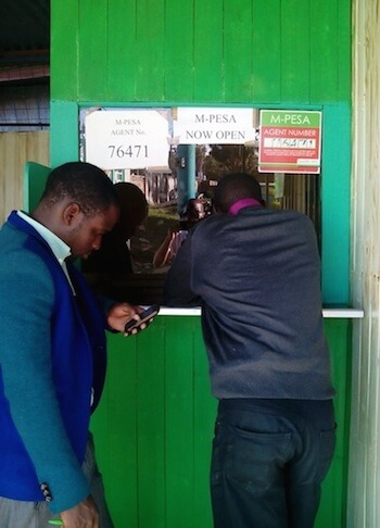 M-PESA agent with people queuing outside
