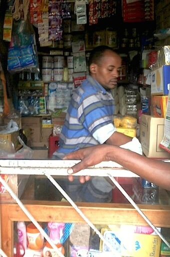 Nairobi M-PESA agent in a shop
