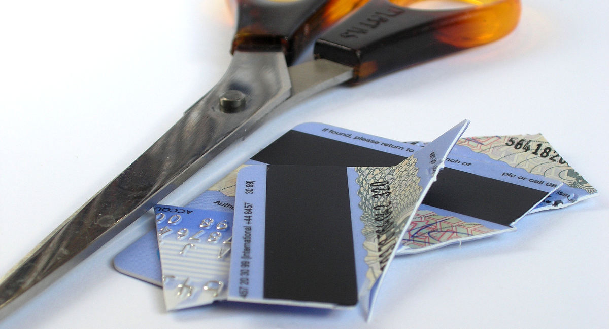 cut up credit card next to scissors