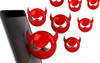 devil emojis rising from mobile phone