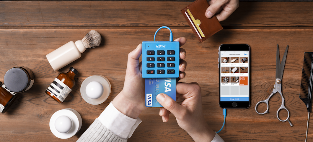 iZettle Lite card reader with chip card and connected to iPhone