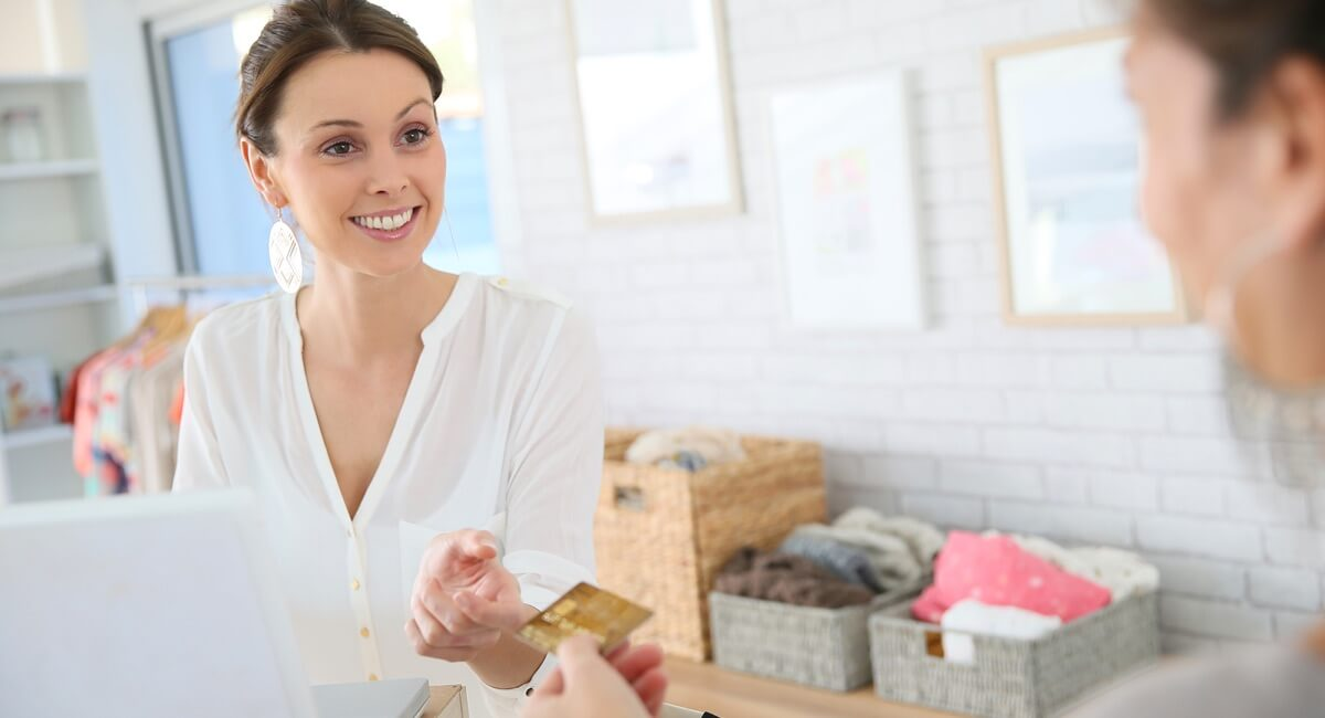 friendly woman being handed a card for payment