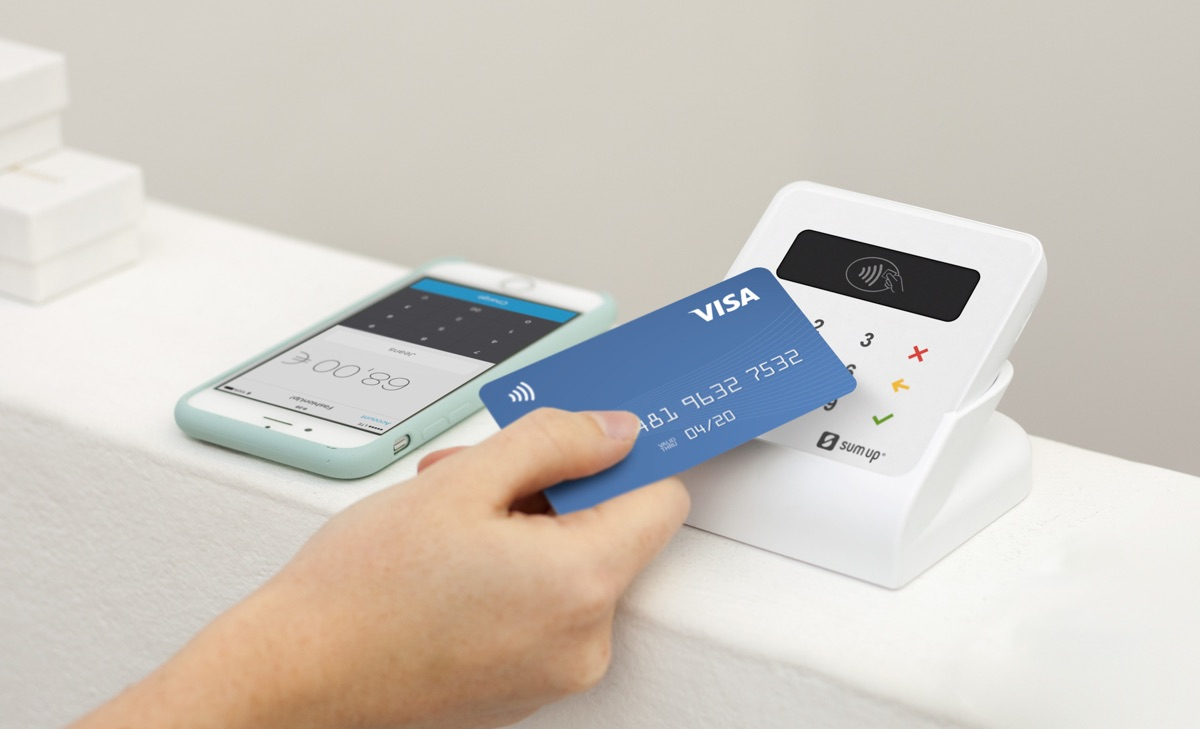 Debit card tap on SumUp Air on countertop