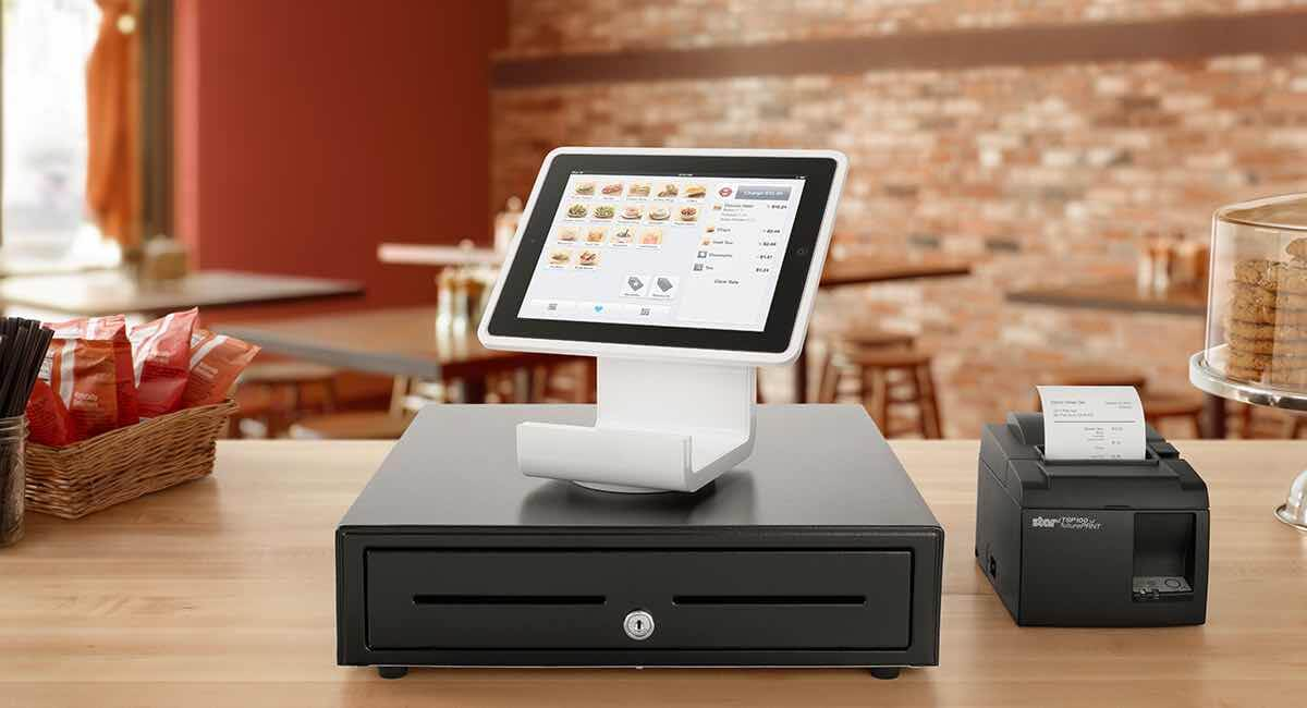 Square Stand on cash drawer on wooden countertop