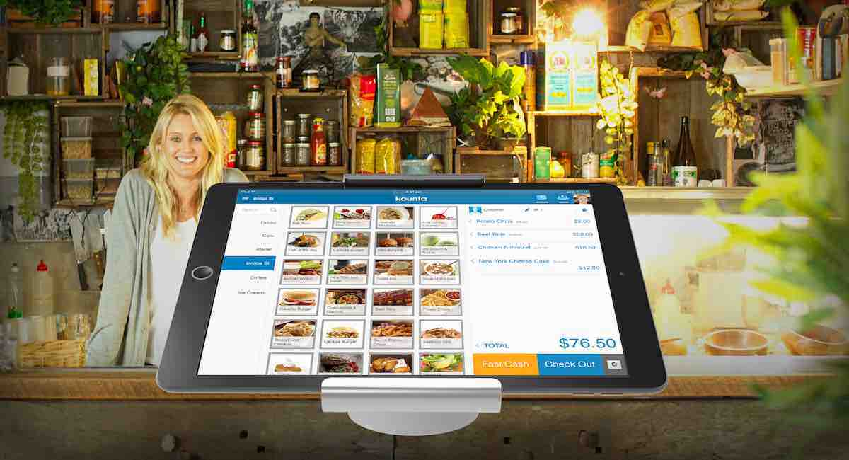 iPad stand with POS display on counter with smiling woman