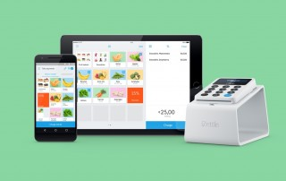 iZettle Reader on Dock with app on iPhone and iPad