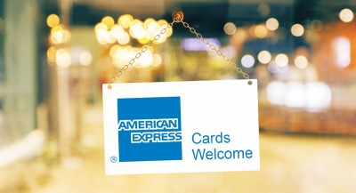 """""""Amex card welcome"""" shop window sign"""