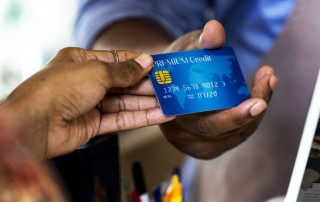 Credit card handed to till assistant