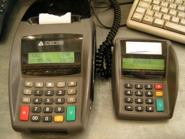 old-generation Ingenico desktop terminal with PIN pad