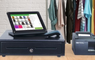 Loyverse app on iPad above cash drawer