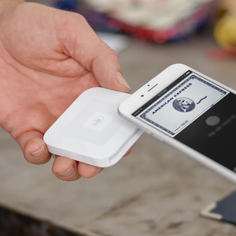 Customer paying with Apple Pay on Square Reader